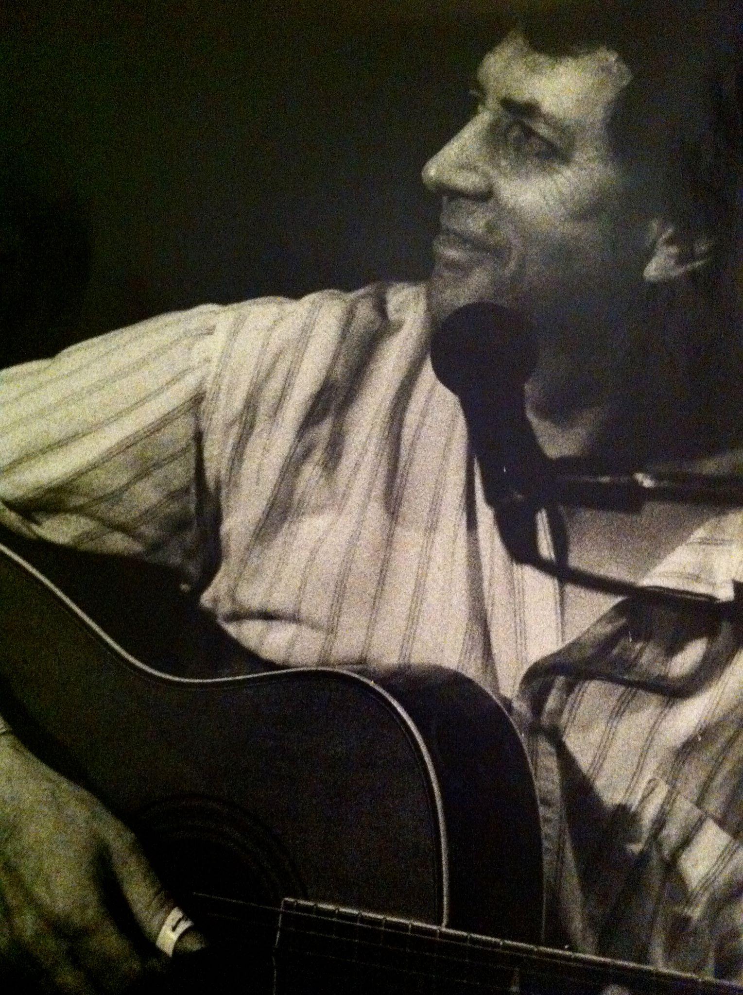 Bert Jansch holding a guitar